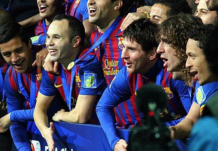Messi (centre) and his teammates celebrating winning the FIFA Club World Cup in December 2011 FC Barcelona Team 2, 2011.jpg