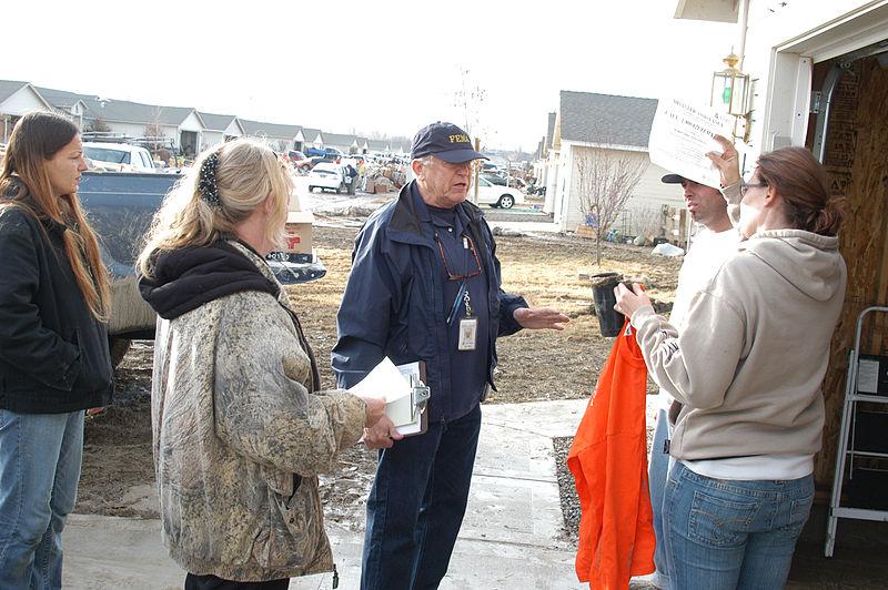 File:FEMA - 33984 - FEMA Community Relations(CR) Specialist talking to residents.jpg