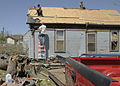 FEMA - 40806 - Workers cleaning a damagaed roof in Arkansas.jpg