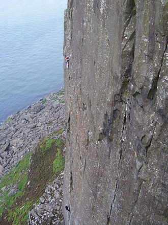 Fair Head - Climbers on the second pitch of Jolly Roger (grade E3/6a) at Fair Head.