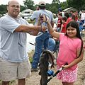 Father and daughter hold fish.jpg