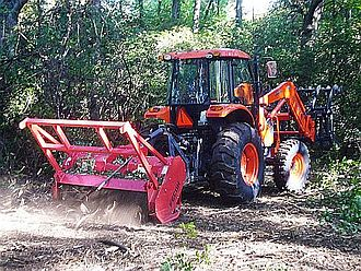 Forestry mulching - PTO-driven forestry mulching attachment on an agricultural tractor
