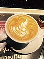 Flat white coffee with pretty feather pattern.jpg