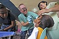 Flickr - Official U.S. Navy Imagery - A doctor examines a seven-year-old patient at Paaralang Elementary School during a medical civil action project during Pacific Partnership 2012..jpg