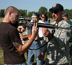Camp Perry - Spc. Joseph Hein, U.S. Army Marksmanship Unit, instructs a student on the intricacies of the M-16A2 rifle during the Small Arms Firing School, Aug. 1, 2009 at Camp Perry, Ohio.