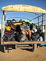Flickr - Tour d'Afrique - Paul guards the baggage truck as it arrives at stadium camp in Wadi.jpg