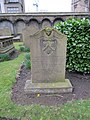 Flower by the headstone - geograph.org.uk - 1801528.jpg