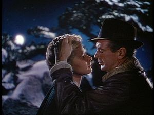 For Whom the Bell Tolls (film) - Guerrilla fighters Robert Jordan (Cooper) and Maria (Bergman) embrace.