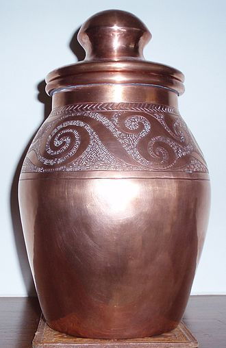 Celtic Revival - Modern copper jar, using a Celtic motif in restrained fashion.