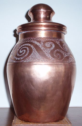 Modern copper jar with a Celtic motif.