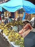 Fruit vendor at Mapusa market, Goa, India.JPG