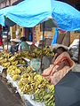 Fruit vendor at Mapusa market, Goa, India.JPG