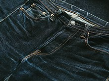 6474e31005b Natural fading on a worn pair of selvedge jeans. Sometimes referred to as  'whiskers' or 'honeycombs'