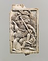 Furniture plaque carved in relief with a male figure slaying a griffin MET DP110683.jpg