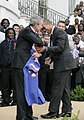George W. Bush gets game ball from Chris Leak 20070319-2 d-0228-4-733v.jpg