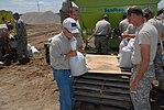 Governor Mitch Daniels assisting Guardsmen in sandbag operations.jpg