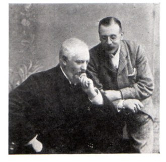 Edward Moss - Edward Moss standing, and Richard Thornton seated