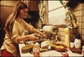 HOUSEWIFE IN THE KITCHEN OF HER MOBILE HOME IN ONE OF THE TRAILER PARKS. THE TWO PARKS WERE CREATED IN RESPONSE TO... - NARA - 558298.tif