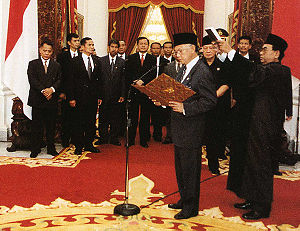 May 1998 riots of Indonesia - B. J. Habibie takes the presidential oath of office following Suharto's resignation, one week after the violence. He later appointed a fact finding team to investigate the May riots.