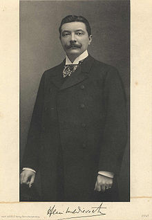antique photo of a formally dressed dark haired man