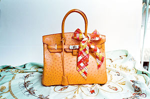 Birkin bag - Hermès Ostrich Birkin bag, with matching leather-covered lock and key lanyard, displayed with a plaid bow