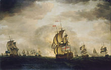 An oil painting depicting a sea battle. The sky has dark clouds with patches of blue, and the sea is grey. Warships are visible in the distance, some of which are exchanging cannon fire. A British warship occupies the centre foreground, obscuring an explosion behind it.
