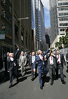 John Howard and U.S. President George W. Bush wave to the public in a Sydney street after leaving the Commonwealth Parliament Offices and walking to the InterContinental Hotel at APEC in September 2007
