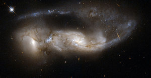 Atlas of Peculiar Galaxies - NGC 6621/NGC 6622 (Arp 81), a pair of spiral galaxies 100 million years after their colliding.