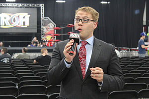 Ian Riccaboni - Riccaboni performing a mic check at Ring of Honor's Global Wars 2015 show in May 2015.