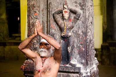 A sadhu in Madurai, India Indian sadhu performing namaste.jpg