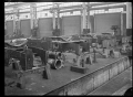 Interior of one of the Hutt Railway Workshops, Woburn, 1930. ATLIB 295245.png