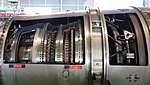 Ishikawajima-Harima F100-IHI-220E turbofan engine(cutaway model) combustor & turbine section left side view at JASDF Hamamatsu Air Base September 28, 2014.jpg