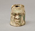 Janus-faced aryballos depicting a Nubian and a bull MET 2008.546 front.jpg