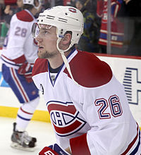 Jiri Sekac in a red and white away Canadiens jersey with his jersey number, 26 on his sleeve.
