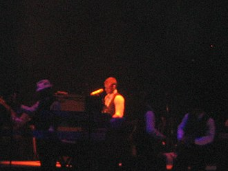 "What Goes Around... Comes Around - Justin Timberlake on a piano while singing ""What Goes Around..."""