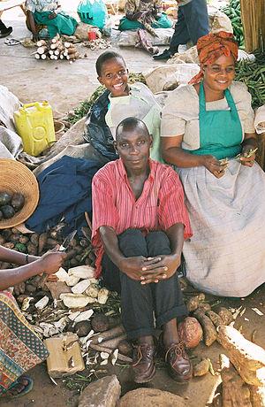 Economy of Uganda - A family in a market in Kampala.