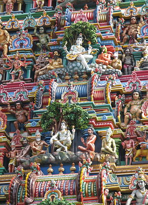 Dakshinamurthy - The Gopuram of Kapaleeshwarar temple, Chennai depicts two sculptures of Dakshinamurthy: one playing the veena, another in a meditative state.