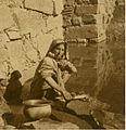 Kashmiri woman washing clothes in August 1937.jpg