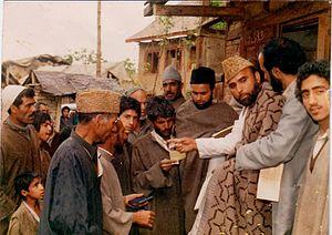 Qazi Nisar - Khyri Aam Members distributing relief at Czogam