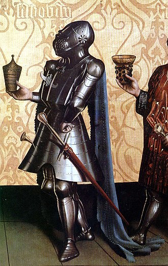 Bascinet - Knight wearing a great bascinet. The strap fixing the helmet to the breastplate is visible as is the impossibility of rotating the helmet. German painting of 1435, by Konrad Witz