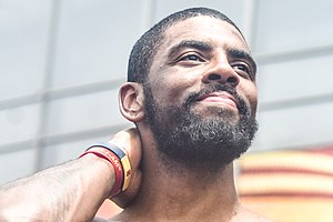 Kyrie Irving during the 2016 NBA Champions victory parade.jpg