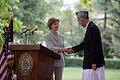 Laura Bush and Hamid Karzai shaking hands before the press in Kabul.jpg