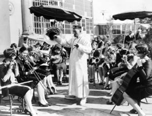 "Mr. Wu - Lon Chaney as ""Mr. Wu,"" conducting an orchestra of women."