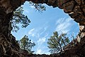 Looking out of the Big Skylight Cave in the Big Tube area of El Malpais National Monument.jpg