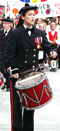 A drummer in a parade.