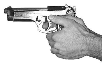 Pistol M9 (Beretta 92F) in Fist Grip