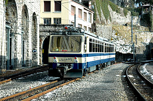 Montreux–Glion–Rochers-de-Naye Railway - A Rochers-de-Naye train in a siding at Montreux; the running line enters the tunnel to the left of the train; the line on the right belongs to the MOB