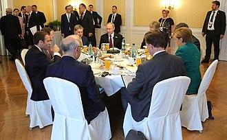 Russia–European Union relations - European Union Leaders Emmanuel Macron of France and Angela Merkel of Germany with Russian President Vladimir Putin meet in Hamburg, Germany in July 2017.