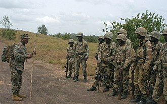 Armed Forces of Liberia - A U.S. Marine Corps officer speaks to AFL troops during a 2009 training exercise.