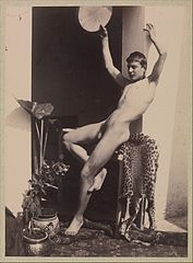 Male Nude Seated on Leopard Skin.jpg